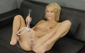 Babe blonde Karina is playing with her lovely vacuum toy on sofa