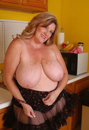 SSBBW Blonde with fat body Deedra is undressing and then posing