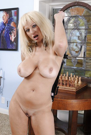 Spicy mature blonde Isabella Rossa touches and rubs her vagina