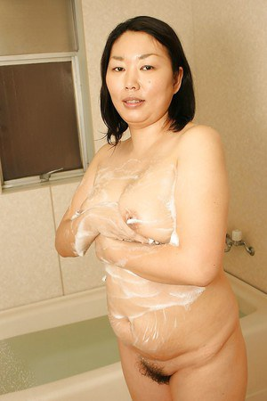 Innocent Asian milf Tamaki Shimai demonstrates her boobies on cam