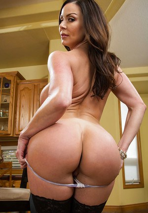 Busty milf Kendra Lust shows her pretty fuckable booty on camera