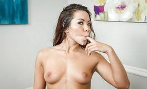 Asian Morgan Lee is getting cum in her wide-opened mouth on camera