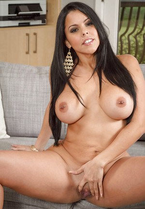 Black-haired model Diamond Kitty presents her stunning big boobs
