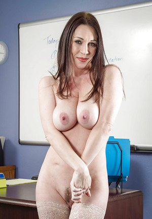 Milf babe RayVeness is playing with her awesome big natural boobs