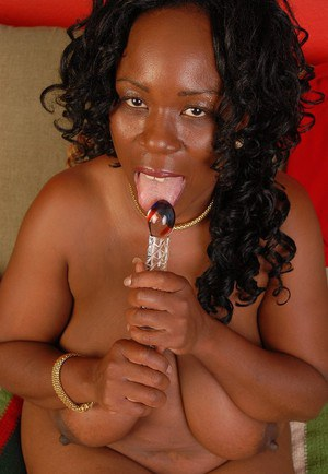 Mature ebony Yvette is sucking her lovely plastic dildo on cam