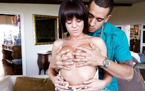 Hot brunette Rahyndee James is swallowing this big tanned wiener