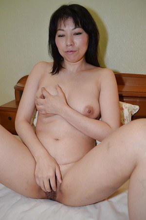 Asian brunette Shigeko Yokoi shows us her pretty hot big boobies