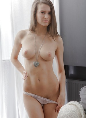 Teen babe Nika is taking off her lingerie and plays with vagina