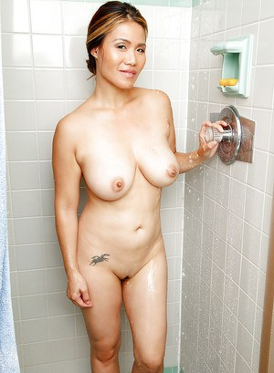Asian milf Lucy Page shows off her big boobies in the bathroom