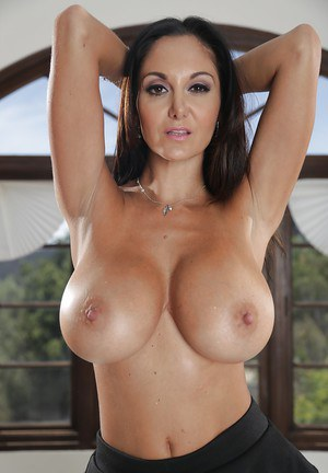 Milf with big boobies Ava Addams is posing and touching her puss