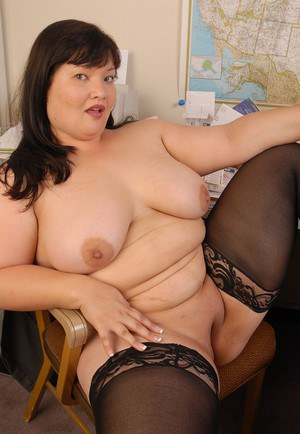 Fatty Asian mature Olivia presents her big boobies and nipples