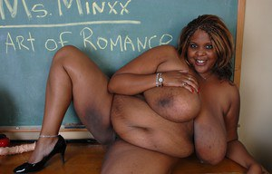 Mature ebony teacher SSBBW Winxx is undressing in the classroom