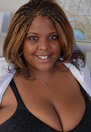 Smiling SSBBW teacher ebony Minxx is undressing in the office