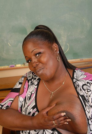 Cute fatty black SSBBW Subrina poses and plays with her boobies