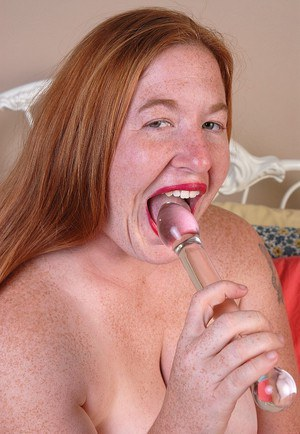 Fatty redhead mature Keno is sucking her plastic sextoy in the bedroom