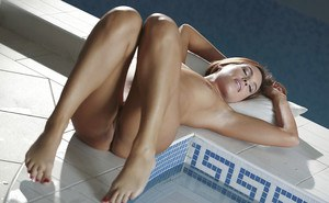 Tanned brunette Jenny Appach slowly takes off her blue lingerie