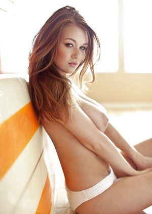 Centerfold babe with tattoos Leanna Decker poses like a pornstar