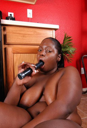 Fatty ebony Dynasty is sucking this amazing black dildo on cam
