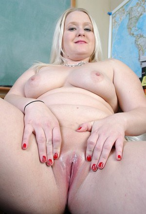 Fatty mature blonde Samantha shows her big boobies in the classroom