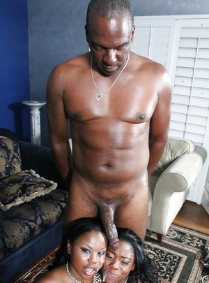 Black sluts Ebony and Laylani are sucking one black dick together