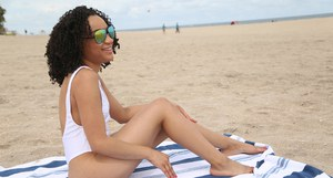 amateur ebony Pixie is posing on the beach in her lovely lingerie