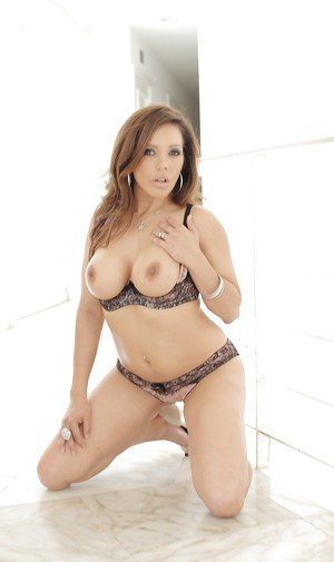 Mature babe Francesca Le is playing with her big boobies!