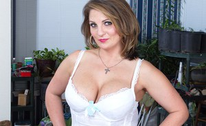 Busty mature Cherrie Dixon takes off her white lingerie slowly