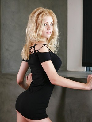Clothed babe blonde Riley Steele is slowly showing her ass!