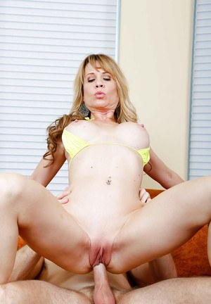 Mom with big boobies Desi Dalton is stroking her little pussy