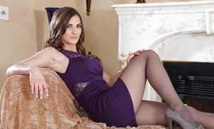 Stunning milf wife Molly Jane is posing on the couch in her lingerie