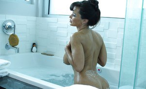 Sweet mature woman Lisa Ann loves being naked and wet in the bathroom