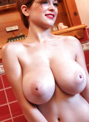 Gorgeous red-head babe Tessa Fowler reveals her fantastically big tits