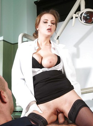 Sweet babe in nurse uniform Candy Alexa sits on guy's hungry mouth