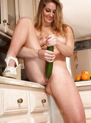 Good-looking amateur babe Veronika Weston shoves cucumber in her pussy