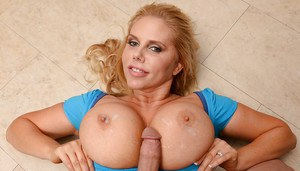 Babe with huge breasts Karen Fisher is glad to see cum on nipples