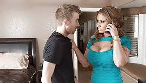Cougar with big tits Eva Notty sucks cock while talking on the phone