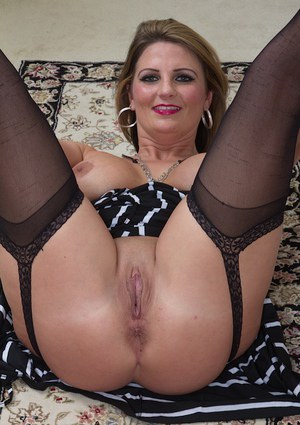 Tattooed mature slut in stockings Cherrie Dixon is hungry for dick