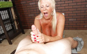 Hot mature slut delivers amazing handjob to her young boyfriend