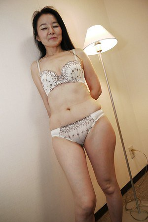 Shy Asian milf Takako Numai likes being filmed naked on camera