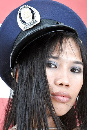 Gorgeous amateur Asian Anne poses in the amazing police uniform