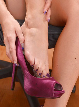 High-class European babe Blanche Bradburry caresses her pretty feet