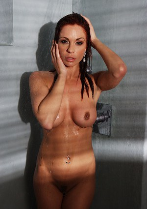 Wonderful red-haired babe Kirsten Price takes shower and rubs melons