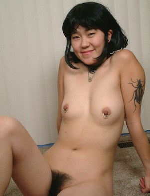 Slender amateur Asian Cady puts her hairy coochie under scrutiny