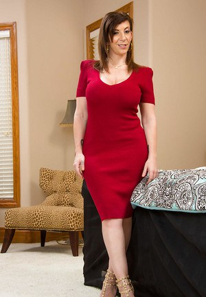 Sultry mom Sara Jay taks off red dress and reveals giant tits