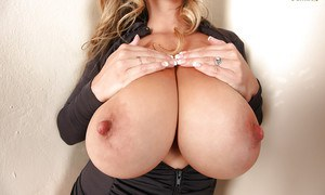 Tattooed beauty with big nipples September Carrino dandles her tits