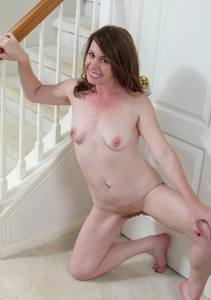 Hairy mature babe Joanie Bishop does nice close-up shots of her ass