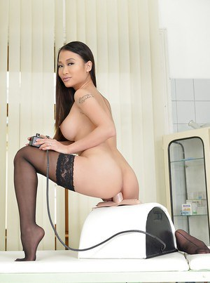 Asian babe in stockings PussyKat gets her ass drilled by sex machine