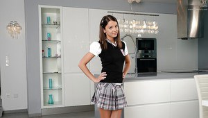 Charming schoolgirl undressing in the chemistry lab exposing her tits