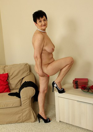 Big tits mature Karoline on high heels has hard nipples and great legs