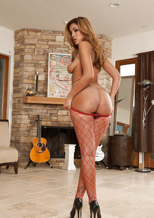 Isis Taylor and her long sexy Latina Milf legs in fishnet stockings